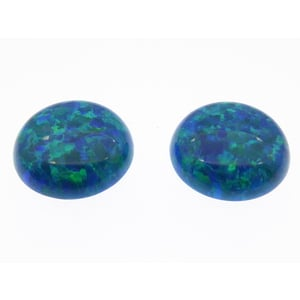 2 Stk. synth. Opale 12mm  Cabochon Peacock Blue |  | Artikelnummer: 5